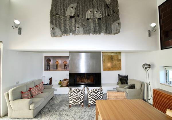 Seating area with fireplace in holiday villa, Lisbon Coast