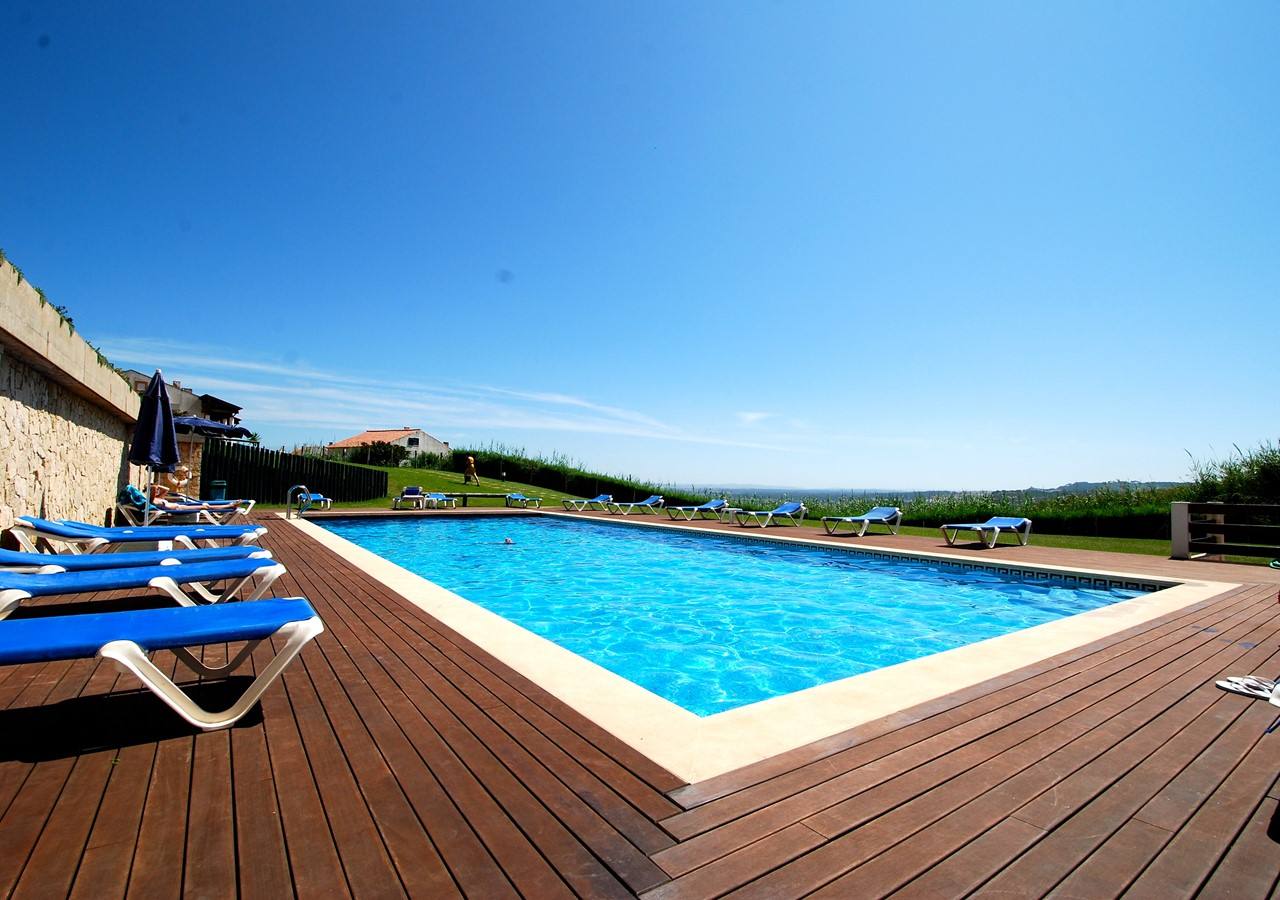 Pool area with sun loungers for guests