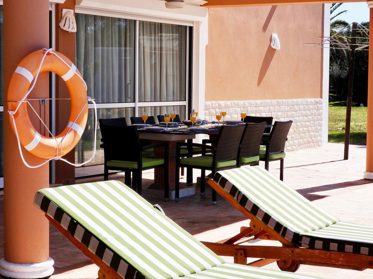 Sun loungers around the pool