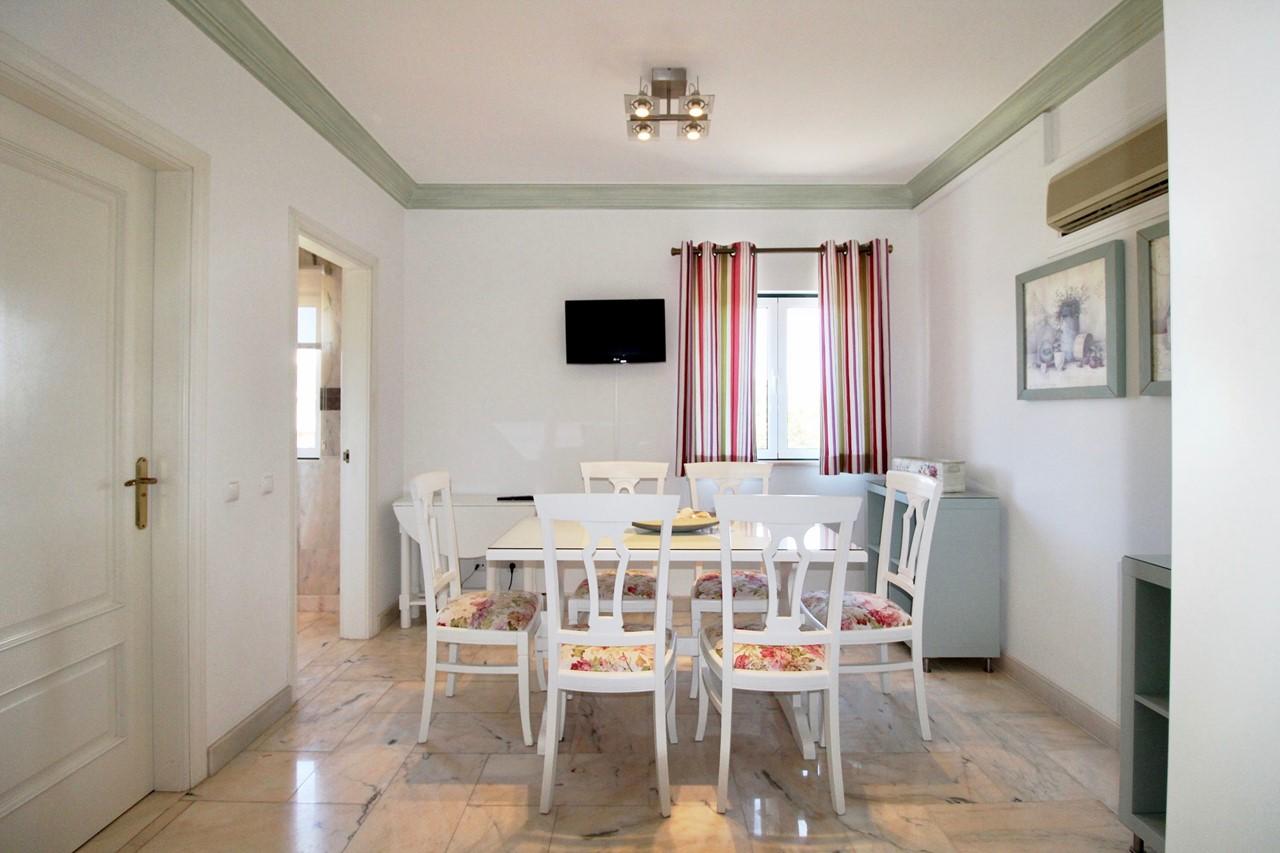 Dining area next to luxury kitchen
