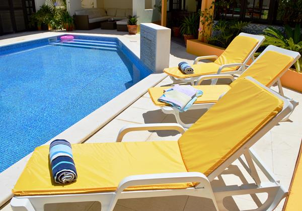 Sun Loungers Around The Pool