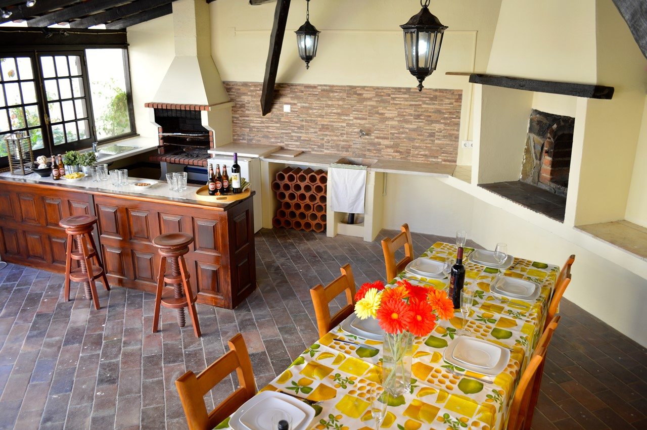 Large kitchen with barbeque and dining area