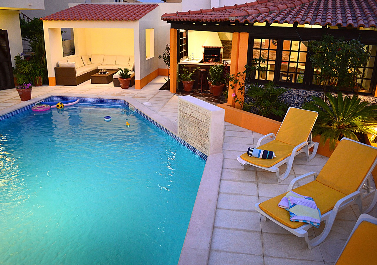 Pool area with sun loungers