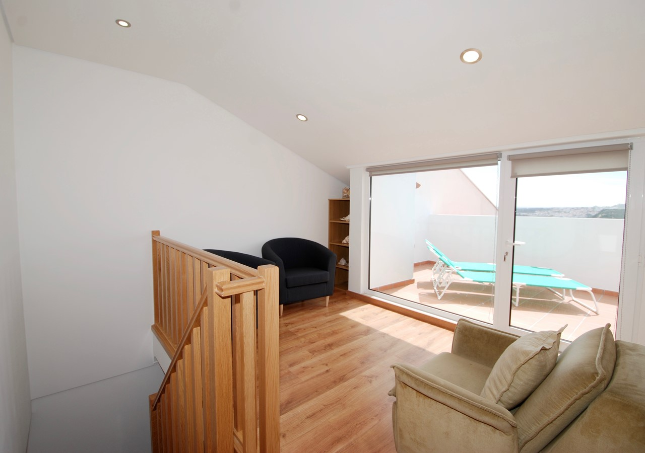 Sitting area with balcony overviewing the sea